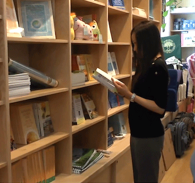 Student perusing books at MUM bookstore
